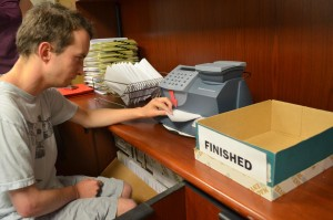 EV Office Solutions employee prepares postage